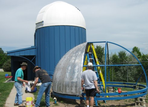 Rivet crew skins the frame of the new dome