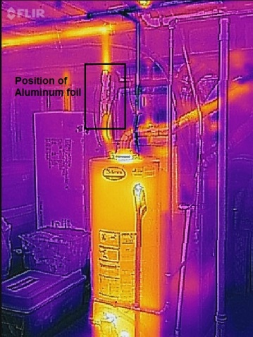 Home water heater. Aluminum foil on vertical hot water feed line